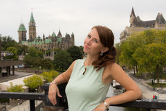 Cute casual young woman smiles in downtown Ottawa, Canada Stock Photos