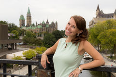 Cute casual young woman smiles in downtown Ottawa, Canada Royalty Free Stock Image
