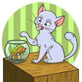 Cute cat looking at fish in a bowl Stock Image