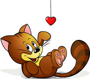 Cute cat playing with heart decoration Stock Photo
