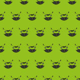 Cute cat's head seamless pattern on a green background Royalty Free Stock Photography