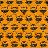 Cute cat's head seamless pattern on an orange background Stock Photos