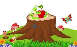 Cute caterpillar wit red apple cartoon on the stump up Royalty Free Stock Image