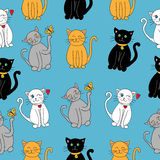 Cute cats pattern. Cute cats seamless pattern on a blue background Stock Image