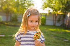 Cute cauasian baby girl and big lollipop Stock Images