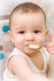 Cute caucasian baby eating Stock Photos