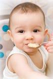 Cute caucasian baby eating Stock Photos