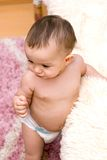 Cute caucasian baby near the bed Royalty Free Stock Photos
