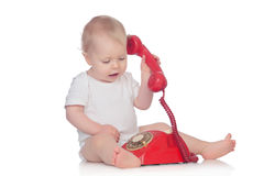 Cute caucasian baby playing with telephone Royalty Free Stock Images