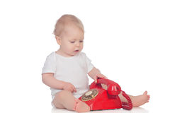 Cute caucasian baby playing with telephone Royalty Free Stock Photography