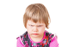 Cute Caucasian blond baby girl angry frowns Royalty Free Stock Image