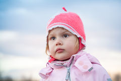 Cute Caucasian blond baby girl in pink hat Royalty Free Stock Image