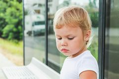 Cute Caucasian blond baby girl sits royalty free stock photography