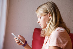 Cute Caucasian blond teenage girl in pink t-shirt Royalty Free Stock Images