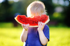 Cute caucasian boy with eating fresh watermelon Royalty Free Stock Photo