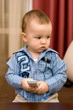 Cute caucasian boy with tv console Royalty Free Stock Photography