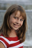 Cute caucasian brunette girl by waterfalls Royalty Free Stock Image