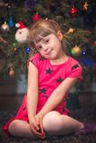 Christmas girl in front of Christmas tree Royalty Free Stock Image