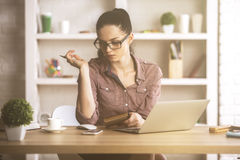 Cute caucasian female at workplace Stock Images