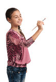 Cute girl draws a brush in space Stock Image
