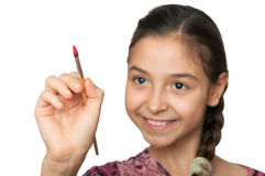 Cute girl draws a brush in space Royalty Free Stock Photo