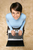 Cute caucasian girl with laptop Royalty Free Stock Photography