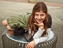 Cute Caucasian Girl on Table Outdoors Royalty Free Stock Images