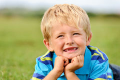 Cute caucasian kid smiling outdoors Royalty Free Stock Photos