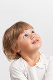 Cute Caucasian little girl looking up, closeup portrait Stock Images