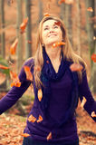 Cute Caucasian Model. With falling leaves, vintage colors stock photo