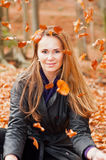 Cute Caucasian Model. With falling leaves in a forest stock photo