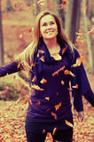 Cute Caucasian Model. With falling leaves in a forest stock photography