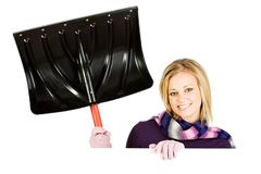 Winter: Woman Holding Up Snow Shovel royalty free stock images