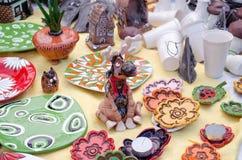 Cute ceramic handmade censer moose smoke nose. Cute original ceramic moose form censer and  smoke rise through nose and other colorful decors in spring fair Stock Image