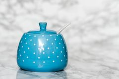 Cute Ceramic Storage Jars with Dots on White. Marble background stock photo