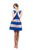 Cute charming feminine woman in blue short dress smiling with head on hands. Royalty Free Stock Photography