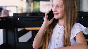 Young teenager girl using and talking with cell phone. stock video footage