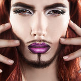 Cute charming male model with magenta makeup looking at camera Royalty Free Stock Photos