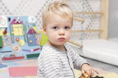 Cute cheeky toddler in the game room.  Stock Image