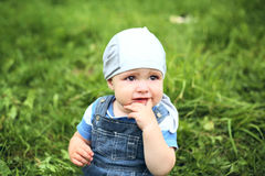 Cute cheerful boy in hat in summer park Stock Photo