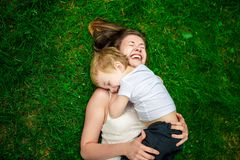 Cute cheerful child with mother play outdoors Stock Photography