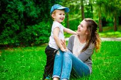 Cute cheerful child with mother play outdoors Royalty Free Stock Photo