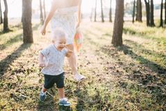 Cute cheerful child with mother play outdoors in park royalty free stock photography