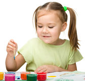 Cute cheerful child play with paints Stock Photos