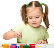 Cute cheerful child play with paints Royalty Free Stock Photos