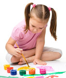 Cute cheerful child play with paints Royalty Free Stock Image