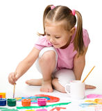Cute cheerful child play with paints Stock Photography