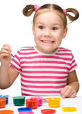 Cute cheerful child play with paints Stock Images