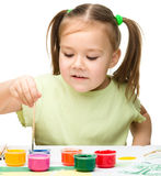 Cute cheerful child play with paints Royalty Free Stock Photo
