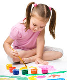 Cute cheerful child play with paints Stock Image
